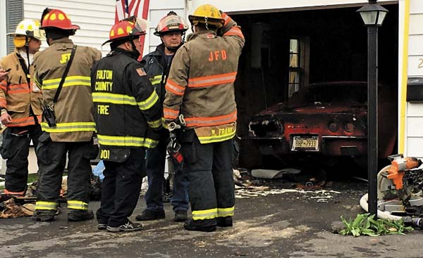 Quick response confines fire damage to garage